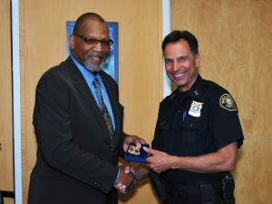 Commander Kevin Modica (left) with Portland Police Bureau Chief Mike Reese (right) at July promotion ceremony