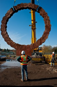The first of two earth cast sculptures being installed at future SE Tacoma/Johnson Creek Station