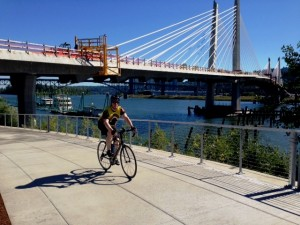 A cyclist enjoys the new Eastside Greenway Trail on June 30, 2014 during the first hours of the unofficial re-opening.