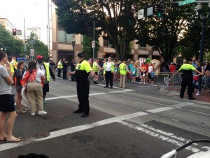 The Starlight Run and Parade holds for a moment as TriMet buses and trains are allowed to cross at W. 5th and Burnside.