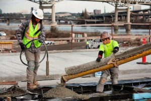 Workers pouring concrete as part of the Portland-Milwaukie Light Rail Transit Project.