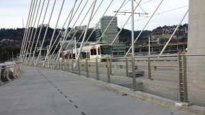 The first MAX train travels over the Tilikum Crossing.