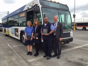 TriMet's honors its operators of the year: (L-R) Lyn Simons, Bus Operator of the Year; Catherine McLendon, Part-Time Operator of the Year; James Hilliard, MAX Operator of the Year join TriMet General Manager Neil McFarlane