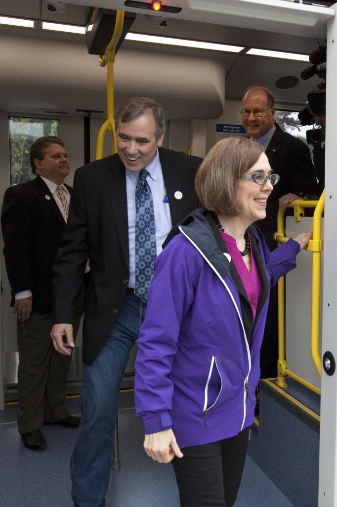 Oregon Gov. Kate Brown, U.S. Sen. Jeff Merkley and TriMet General Manager Neil McFarlane complete the first ride on the future MAX Orange Line.