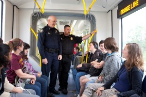 Transit Police Commander Mike Leloff (left) and Milwaukie Police Chief Steve Bartol (right) talk with students about the MAX Orange Line and safe behavior around trains.