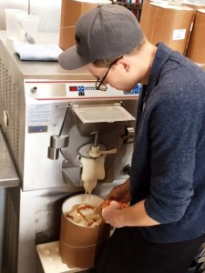 Salt & Straw head ice cream maker Tyler Malek mixes up a batch of MAX Orange Line-inspired ice cream