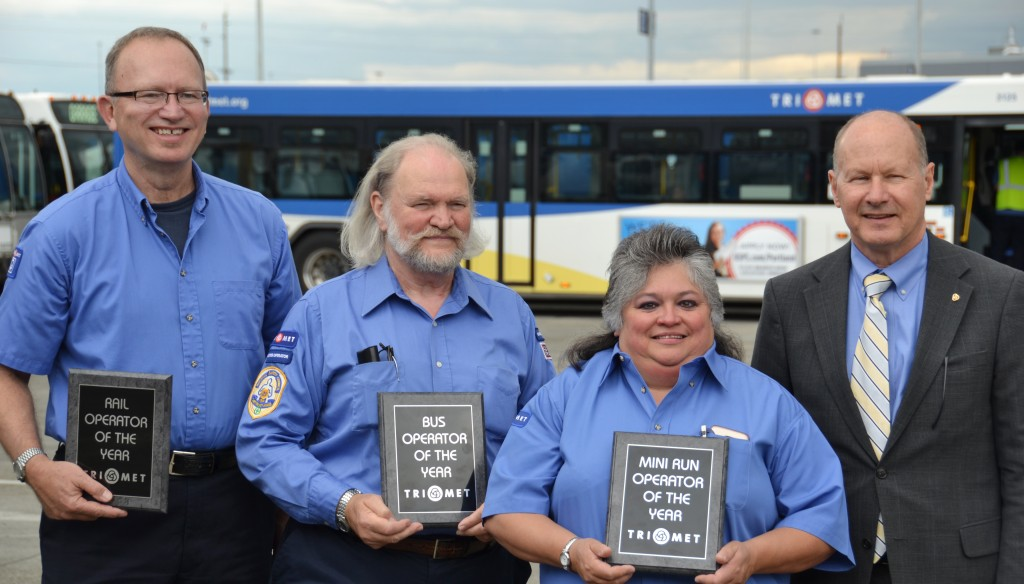 TriMet recognized its best operators of the year: (L-R) Jeffery Evans, MAX Operator of the Year; Alex Ohly, Bus Operator of the Year; Justina Carrillo, Part-Time Operator of the Year, join TriMet General Manager Neil McFarlane.