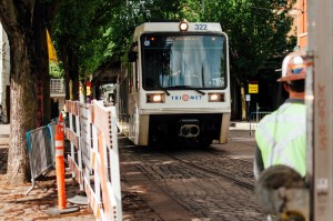 Test train goes along new curved rail near Skidmore Fountain