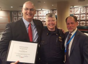 Former Transit Police Commander and now Assistant Chief Mike Leloff was honored for his service by the TriMet board of directors on Wed., August 10. New Transit Police Commander Sara Westbrook was introduced to the board. (Left to right: Leloff, Westbrook and TriMet Executive Director of Safety & Security Harry Saporta)